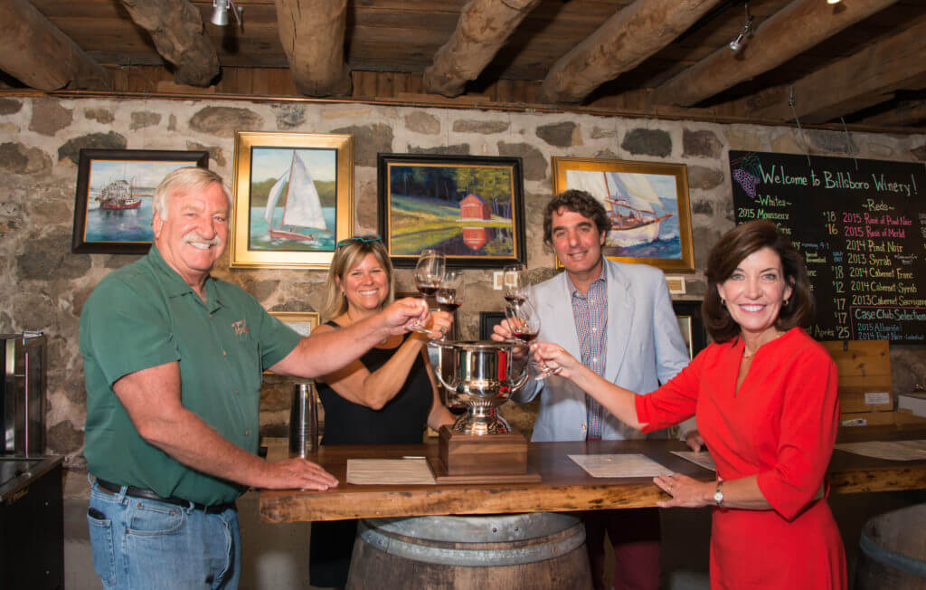Kim and Vinny celebrate with Sawmill Creeks grape growers after their Governor's Cup win.