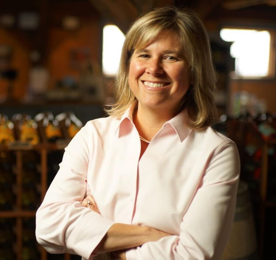 Kim Aliperti smiling in the tasting room of Billsboro.