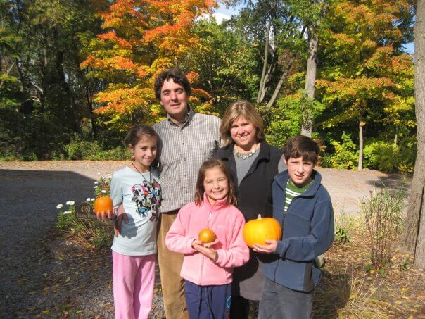 Kim, Vinny, and their three children in their first harvest season as Billsboro owners.